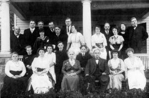 Charles F Hopkins and his wife Hettie are front center.